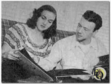 Howard Culver (R) and his wife Mimi (L) going over some photographs (1947)