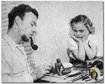 Howard with daughter Pamela showing her some modelling in clay (1947)