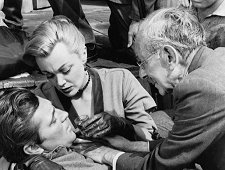 "Robert Mitchum, Jan Sterling, Florenz Ames (as Doc Hughes) in the Western ""Man with the Gun"" (1955)."