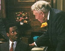 "Billy Ray Valentine (Eddie Murphy) and Randolph Duke (Ralph Bellamy) in John Landis' ""Trading Places"" (1983)."