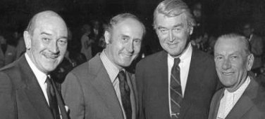 Standing here (L to R) Lee Bowman, Henry Mancini, Jimmy Stewart and Hoagy Carmichael at a salute to Hoagy Carmichael, in Los Angeles, sponsored by the Indiana University Alumni Association, 1973.
