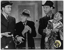 "Ralph Bellamy(Ellery Queen), Charley Grapewin and James Burke (Sgt.Velie) in a scene from ""The Penthouse Mystery"" (1941)"