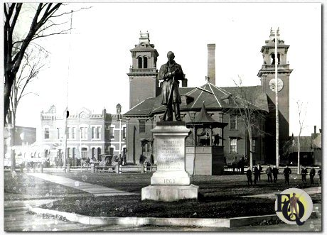 Claremont, NH, has a Square which was round... with five streets hooked up to it. Bandstand and statue included...
