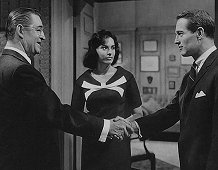 "Ted de Corsia with Ina Balin opposite Paul Newman in a scene from  ""From The Terrace"" (1960)"