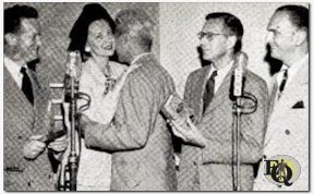 "New Wrinkle in commercial programs is this two play mike setup - NBC at left, CBS at right. Event occurred in NBC studios, Radio City, in presentation of ""Edgars"" for best radio mystery program to the winners, Ellery Queen (CBS) and Mr. & Mrs. North (NBC). Left to right: Joe Curtin (Mr. North); Alice Frost (Mrs. North); Ellery Queen (face lost in embrace); Howard Haycraft; Santos Ortega (Inspector Queen). ""Edgars"" are awarded by Mystery Writers of America, the name honoring Edgar Alan Poe. (July 1946)"