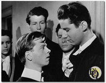 Peter Lawford's first role in a major film production was in A Yank At Eton (1942), starring Mickey Rooney, in which Lawford played a snobbish bully.