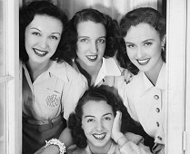 In 1941, for the first time in seven years, Margaret Lindsay was reunited with three sisters. The girls, natives of Dubuque, Iowa, are L to R; (standing) Mrs.John Page Bueheler, wife of a USA officer stationed at the Panama Canal; Mrs. Fredrick C. Keuline of Chicago; Miss Lindsay and Mary Kies, youngest daughter.