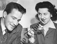 "Mr. and Mrs. Hugh Marlowe (Edith Atwater), who are having a reunion with their Chicago friends while he is here to play opposite Gertrude Lawrence in ""Lady in the Dark"" at the Civic Opera House. (Jan, 1943)."