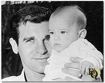 Candid photo of Lee Philips showing his daughter Julie (ca.1960)