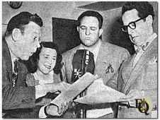 Fred Allen (L) with three of the Alley demimonde (L to R) Minerva Pious, Alan Reed and Kenny Delmar.