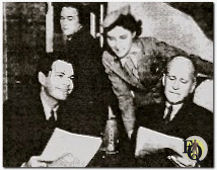 "In January, 1939, Kellogg promoted ""Howie Wing"" by arranging the first dramatic broadcast in radio history made from an airplane, Howie Wing, a Saga of Aviation. (Jan 20, 1939) (L to R) Bill Janney (""Howie""), sound effects man Alexander Binnie, Helen Jacobson was the stewardess and actor Robert Strauss on an unspecified United Airlines airplane,  January 20, 1939."