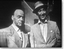 "Lee Bowman (right) in a scene from ""the Red Hook Murder""."