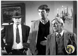"Awaiting the momentary arrival of a mobster suspect are (from left) guest star Kevin Tighe and series stars Jim Hutton and David Wayne. Tighe star of the network's ""Emergency!"" series, appears here as Detective Jim Millay (NBC-photo)"