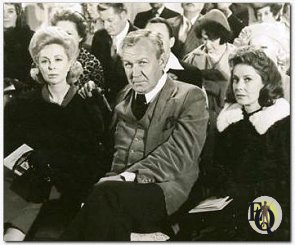 "DEADLY ART AUCTION -- Lillian McGraw (Dr. Joyce Brother, left), her husband, Clint (Forrest Tucker), and her cousin, Celeste (Vera Miles), attend an art auction where Lillian buys the portrait of a woman and soon after is slain in ""The Two-Faced Woman"" on NBC-TV's ""Ellery Queen"" color-cast, Feb.29 (8-9 P.M. NYT)"