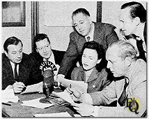 "Starting in 1949 Bill Zuckert was on Mutual's ""Gang Busters"", the show boasted an all-star cast. 	Seated (L to R) Larry Haines, Ken Lynch, Bob Haag, Bryna Raeburn, Bill Zuckert. Standing, director Leonard Bass and announcer Russ Dunbar. Seen here as ""TV Radio Mirror"" Award Winners, 1955-66 as favorite Radio Mystery-Adventure Program."