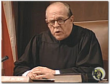 "Zuckert as Judge in the 1973 ""Kojak"" Pilot "" The Marcus Nelson Murders""."