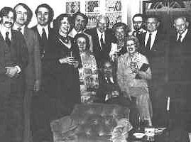 Part of the group who gathered at a reception in President's Cramer's home after the ceremony. Around Fred, seated, with his wife Rose at his left, are from left to right: Steve Stilwell, Al Hubin, Mike Nevins, Marilyn Hubin, Don and Marge Pendleton, Ned and Cathy Guymon, Randy Cox, Bob Fish and John Ball.